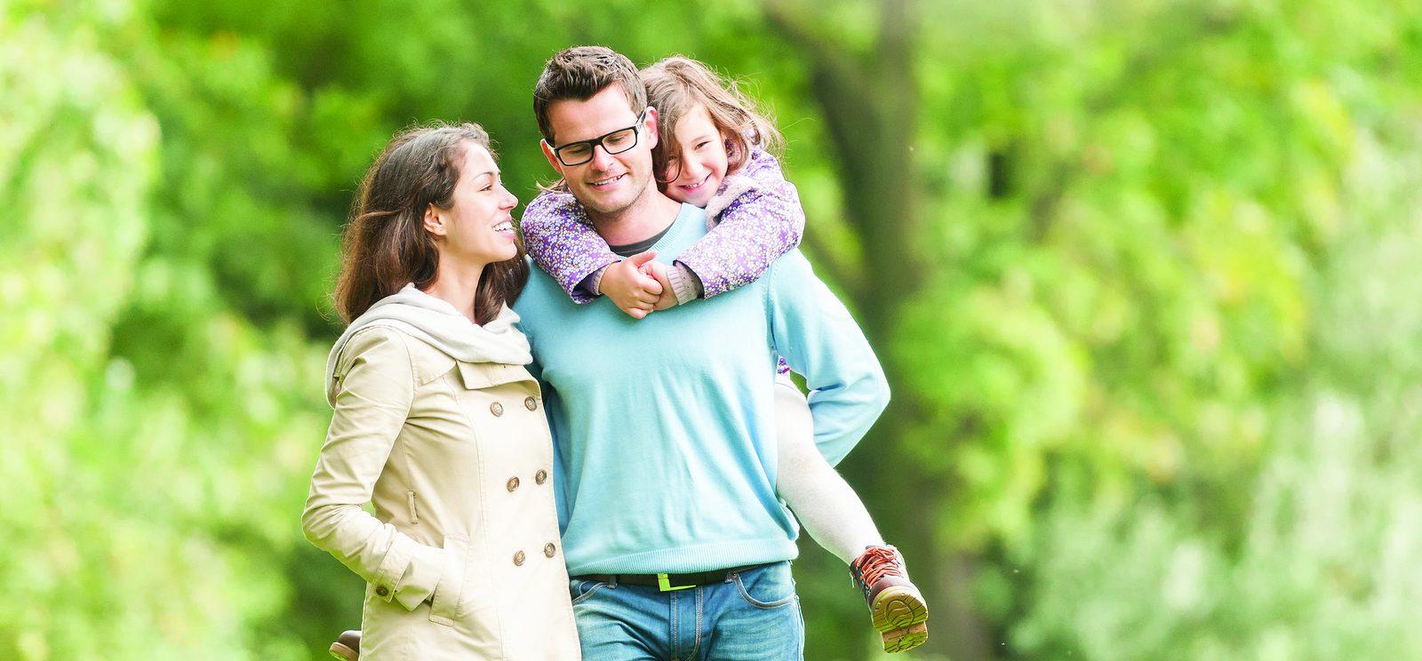Happy family of three having fun outdoor. - Masonic Homes